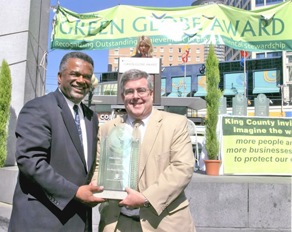 "The Green Globe Award (photo with Ron Simms) was awarded to Port Blakely Communities for ""Leadership in Sustainable Building."